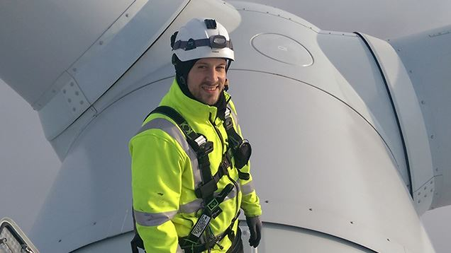 Service technician at the top of an offshore wind turbine