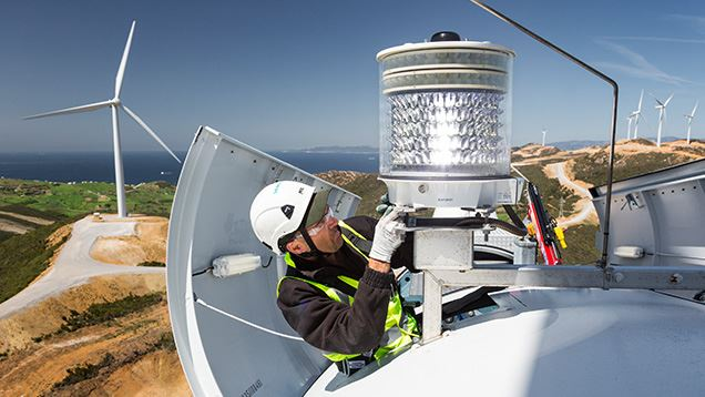 Service technician taking care of onshore wind turbine